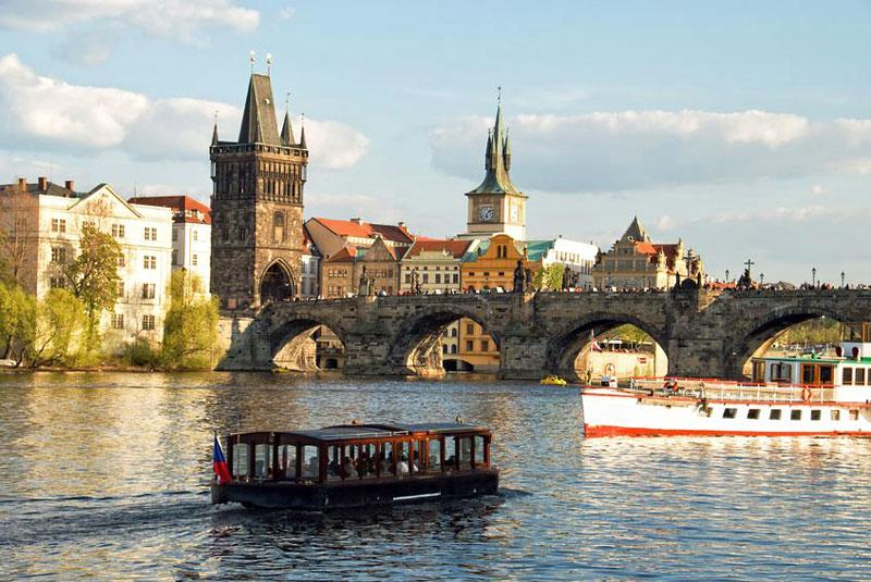 Boats On Vltava River In Prague Praguego